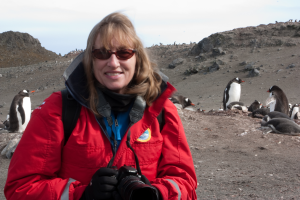 "Dyan deNapoli, ""The Penguin Lady,"" visiting with Gentoo penguins in Antarctica"