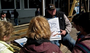 "Timothy Vogel, the ""Gentleman Biologist of Pier 39,"" a Docent for the Marine Mammal Center, talks with young visitors about the area's whales, dolphins, seals and other marine mammals"
