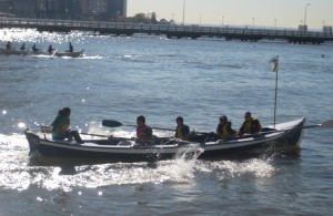 Harbor School's Rowing Team practices at the Pier 40 Village Community Boathouse in Manhattan. Sportsmanship, leadership, hard work and responsibility make team boat handling for competition a fun challenge (Photo: NY Harbor School)