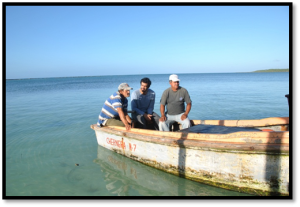 The Ocean Foundation's Fernando Bretos (center) chats with Cuban fishermen on board an outgoing fishing vessel at Bahia Grande, near Cocodrilo on the Isle of Youth
