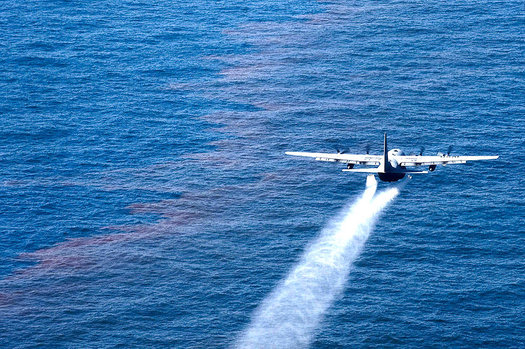 A C-130 Applies Dispersants During the BP Deepwater Horizon Oil Spill (USCG Photo)