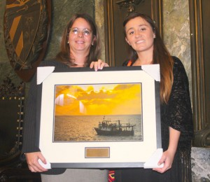 Ocean Doctor's Ximena Escovar-Fadul (right) presents CIM Director, Patricia Gonzalez with a framed photo of CIM's research vessel, Felipe Poey to commemorate CIM's 45th anniversary