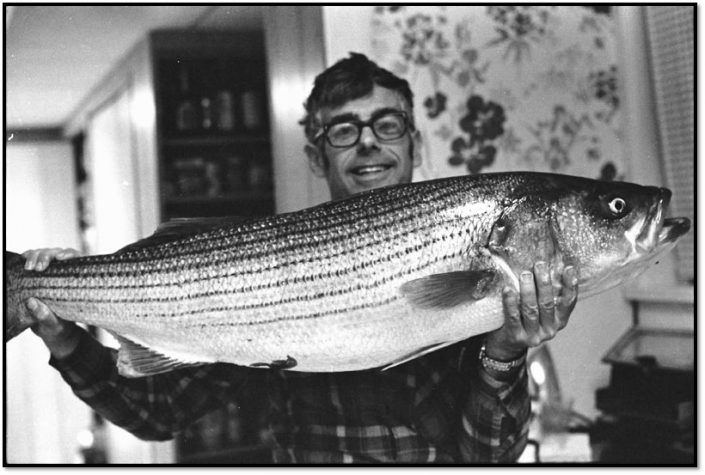 William L. Guggenheim and his favorite fish, a Striped Bass caught off the New Jersey coast. (Photo: Ann Guggenheim, 1976)