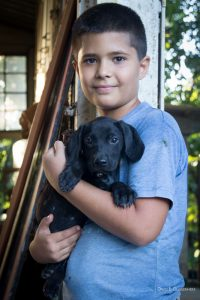 Maylin's son with a rescued puppy